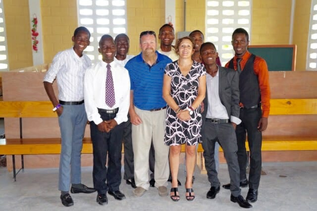Jeff and Terri Swope standing with the Haitian Young Men
